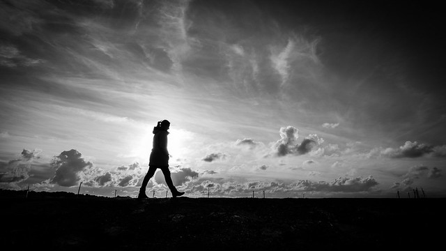Walking alone - Howth, Ireland - Black and white street photography
