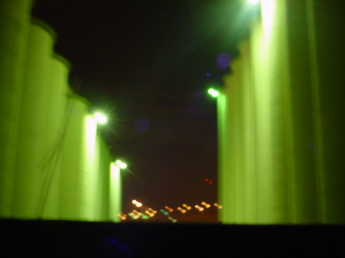 blurred silos at night