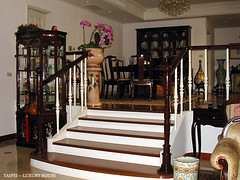 boutique(0.0), winery(0.0), iron(0.0), furniture(1.0), wood(1.0), room(1.0), dining room(1.0), interior design(1.0), stairs(1.0),