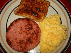 Ham steak, scrambled eggs and toast with strawberr…