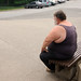fat man near parking lot