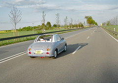 1991 NISSAN Figaro Convertible, while driving by ClassicsOnTheStreet