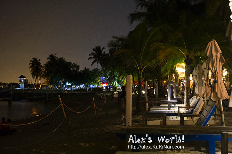 Colourful Siloso Beach on Sentosa Island at night