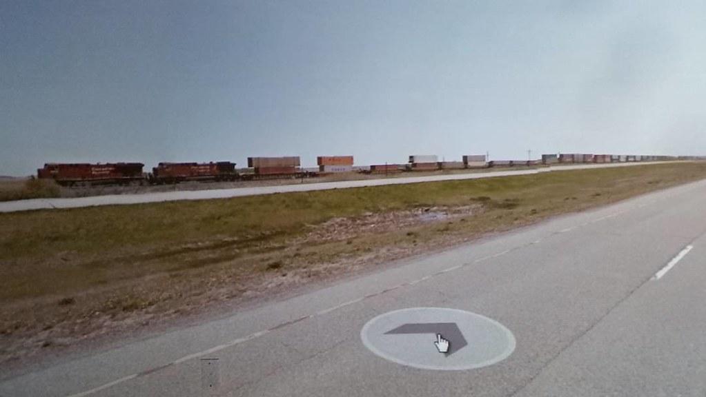 Train for as far as the eye can see. #ridingthroughwalls #xcanadabikeride through #googlestreetview #saskatchewan