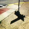 #sign #post #shadow #noon #midday #light