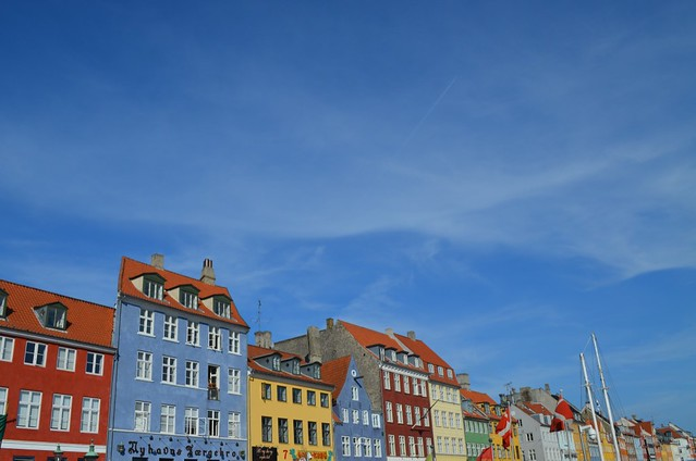 Nyhavn colorful buildings against blue sky Copenhagen
