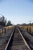 Railroad tracks running SSE parallel to Byron Highway