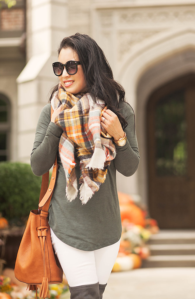 cute & little blog | petite fashion | olive green tunic, white jeans, fringe bucket bag, plaid blanket scarf | fall outfit