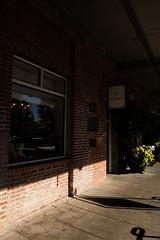 Napa River Inn sign in shadow