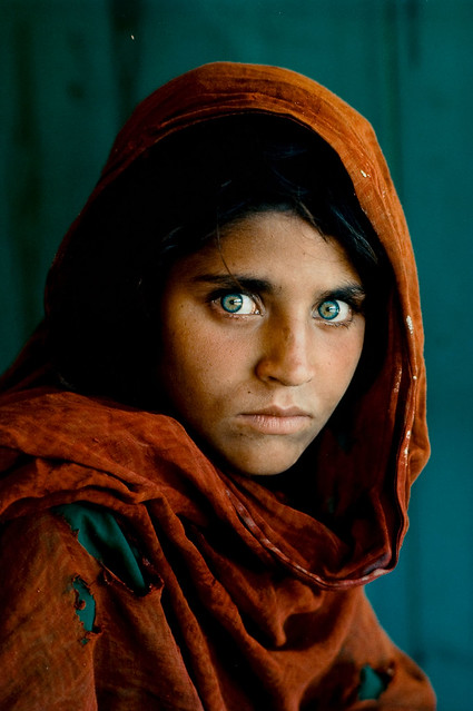 Steve McCurry - Afghan Girl [1984]. This one photo was featured on the cover of National Geographic and touched millions of people with this one image that told the story of Afghan refugees under the Soviet occupation.