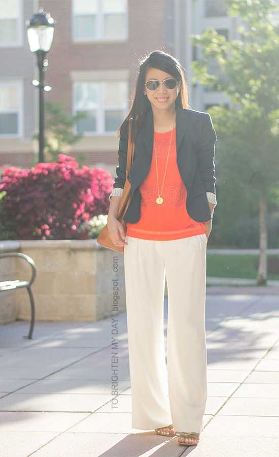 navy blazer, orange lace top, gold coin necklace, white trousers, cognac brown tote