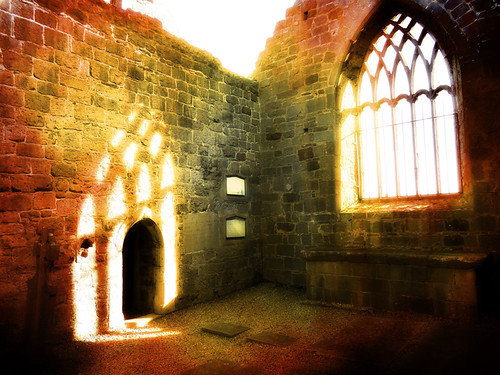 Light coming through the window of an Irish church ruin run through Pixlromatic
