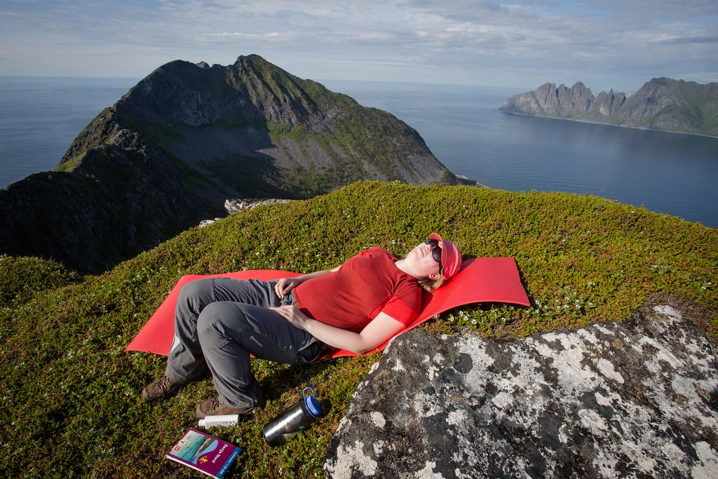 Well deserved rest after steep climb up Steinsethogda (473m). Senja Island. Troms. Norway. #7monthspregnantinpicture
