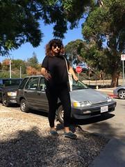 Tall girl, small car.