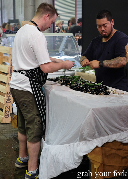 Adding beach herbs to the pipis and mussels to be cooked in the Aboriginal earth oven at Rootstock Sydney 2015