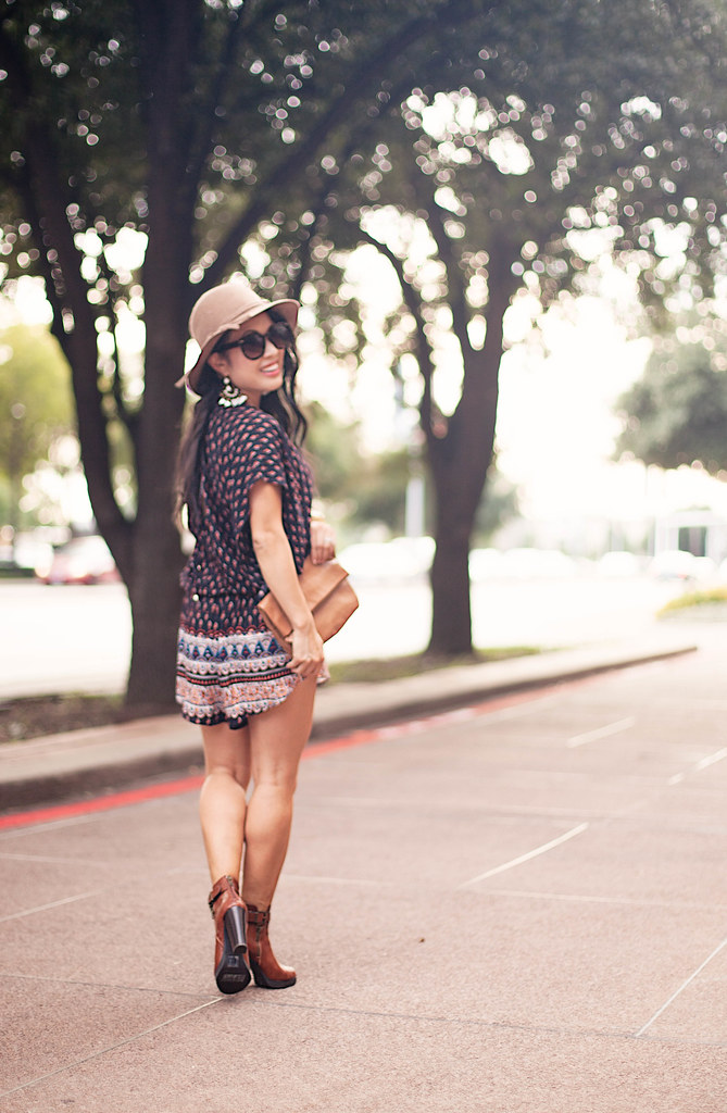 cute & little blog | petite fashion blog | tribal batwing romper, sseko leather clutch, wool floppy hat, ankle booties, statement earrings | fall outfit