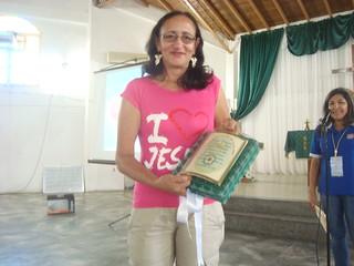 Luz Maria with plaque.
