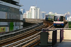 BTS Skytrain arriving at Sala Daeng station near Lumpini park in Bangkok, Thailand