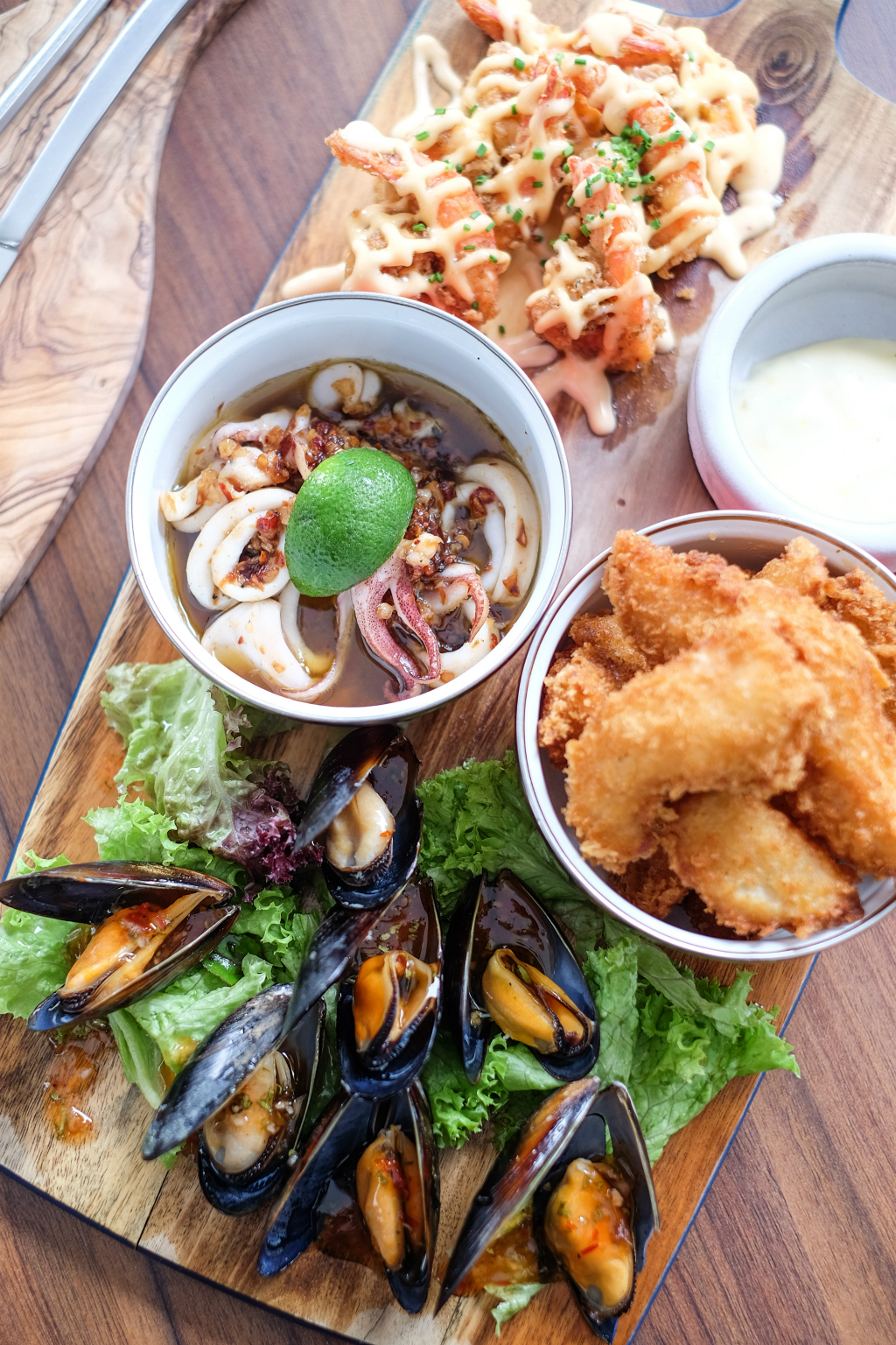 Lighthouse Bistro & Bar: Fishermen's Board, a seafood platter of Atlantic prawns, calamari, black mussels and deep-fried chunks of dory accompanied with a light-whipped Orange Mayonnaise and a House Salad