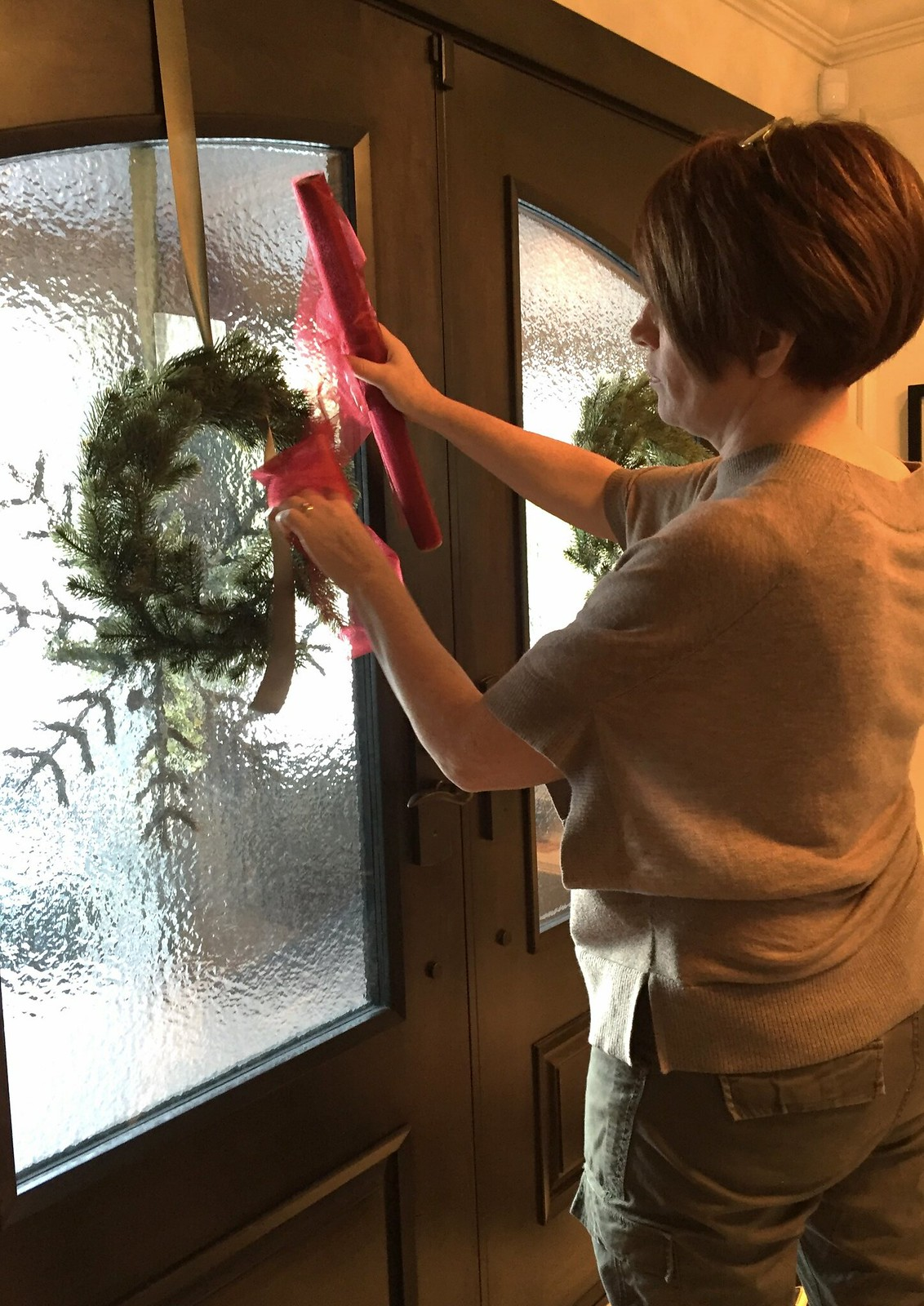 decorating the inside of a door for Christmas