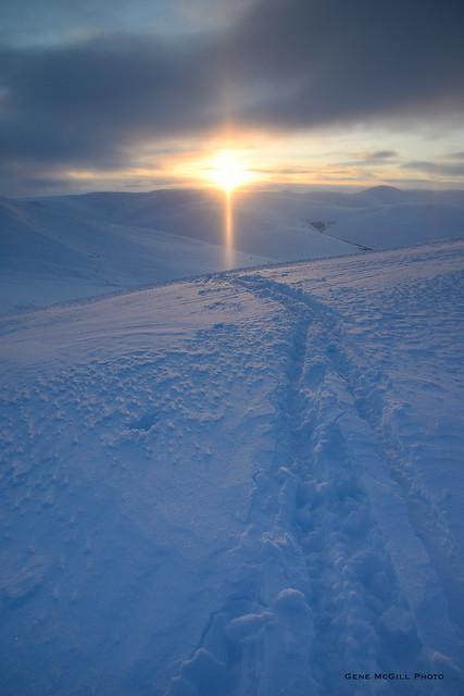 Sun pillar and ski tracks above Eagle Summit