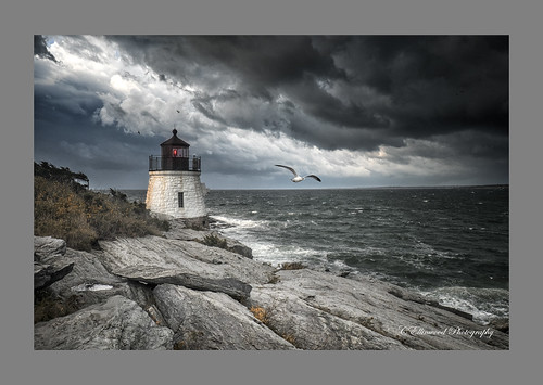 Storm Over Castle Hill Light by Cal Ellinwood via I {heart} Rhody