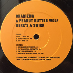 CHARIZMA & PEANUT BUTTER WOLF:HERE'S A SMIRK(LABEL SIDE-A)