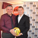 Dennis Wyness presents a signed ball to Stuart Addison who was celebrating his 40th birthday