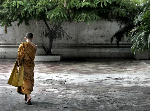 monk in courtyard