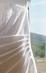 veil(0.0), formal wear(0.0), interior design(0.0), dress(0.0), bridal clothing(1.0), textile(1.0), clothing(1.0), white(1.0), satin(1.0),