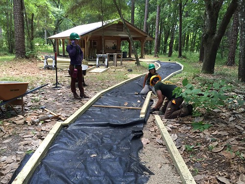 Youth workers constructing an Architectural Barriers Act Accessibility-compliant trail
