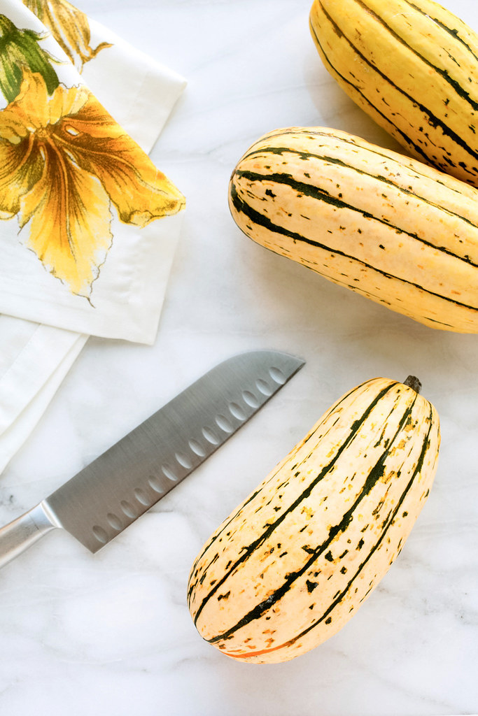 delicata squash on marble board