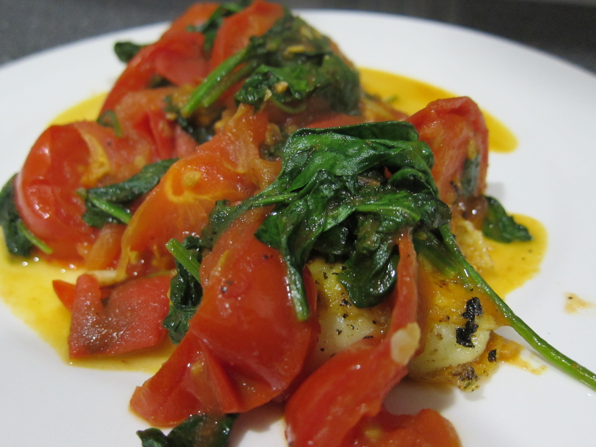Tomatoes and spinach on polenta
