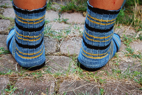 Back view of handknit men's socks with Turtlepurl Live Long & Prosper yarn