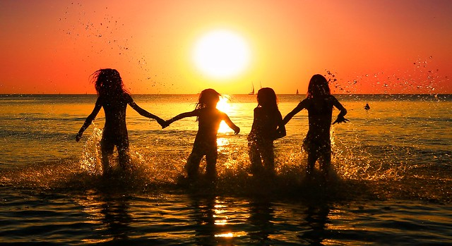 My daughter & her friends bathing in the sea at sunset - Tel-Aviv beach