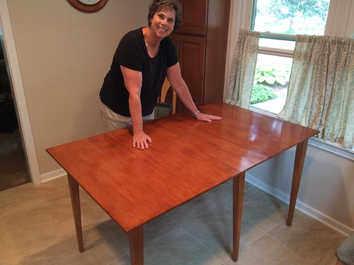 Mom with new kitchen table, leaf up