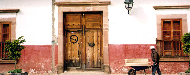 Classic Patzcuaro wall with wooden door and shuttered windows