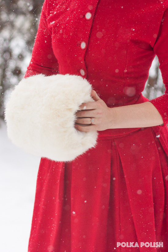 Keeping warm in winter with a vintage white rabbit fur muff and a red wool suit