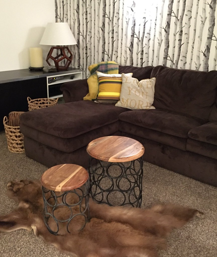 brown sectional in media room with current accents