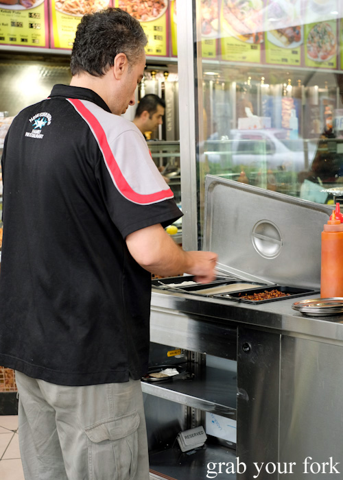 Sauce station with chilli oil, hummus and cacik garlic yoghurt at New Star Kebabs, Auburn