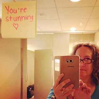 Bathroom selfie with Week of Kindness post-it.