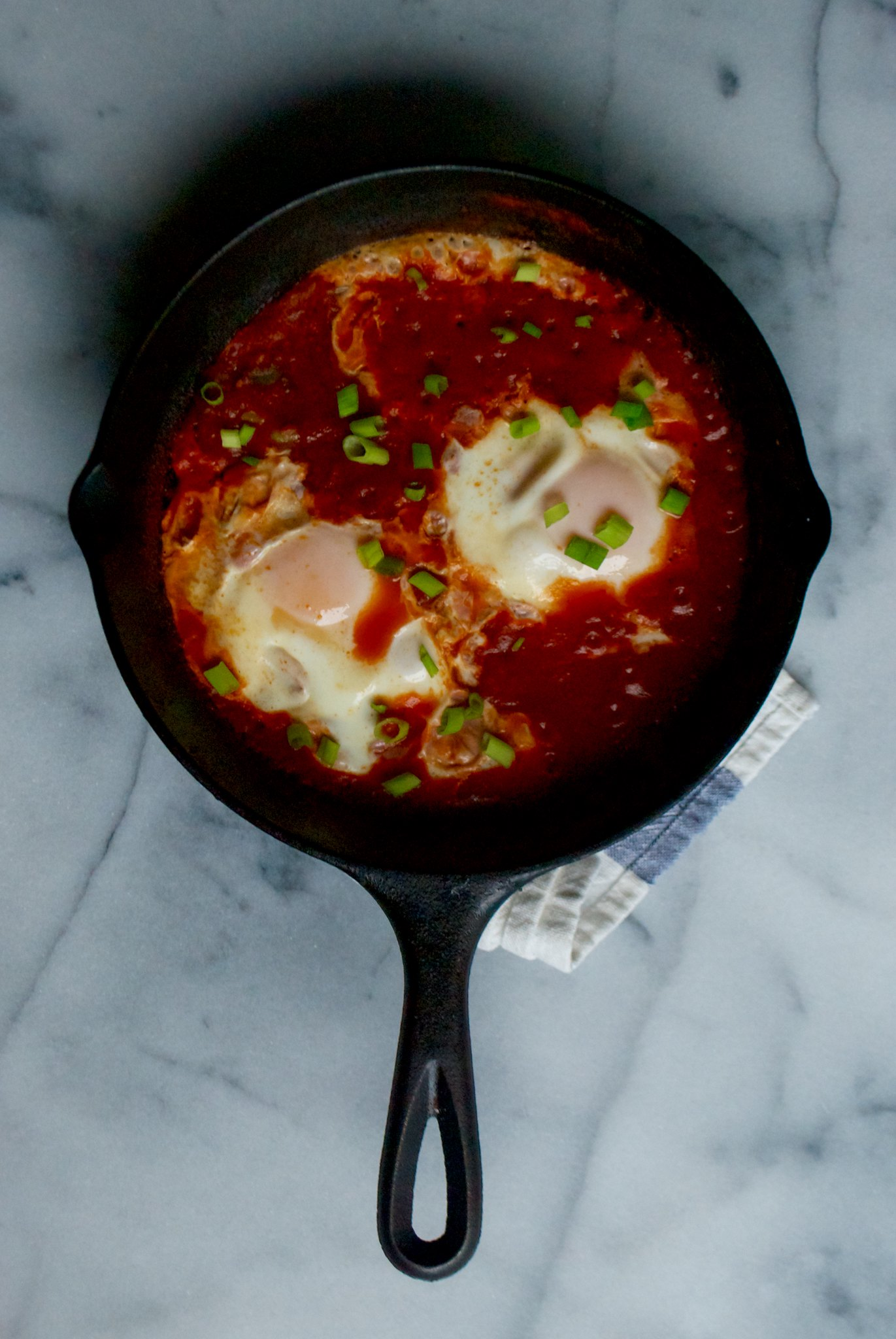 Shakshuka (Eggs Poached in Spicy Harissa Tomato Sauce)