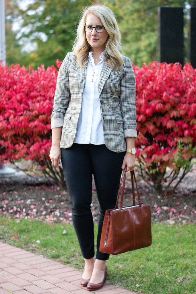 plaid blazer with white top and black pants
