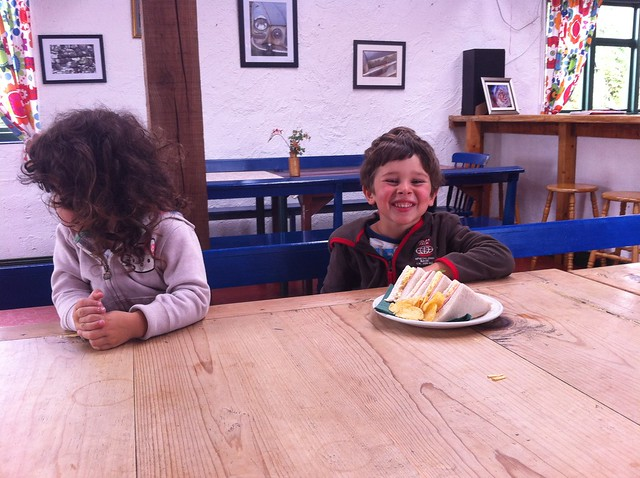 Let's have lunch in Greenan Farm: Mr M and Little Ms E eating sandwiches and crisps in greenan maze cafe