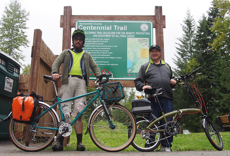 Neil and Dad: My father joined me for a good eight miles on the Centennial Trail, riding his Citizen folding bike.