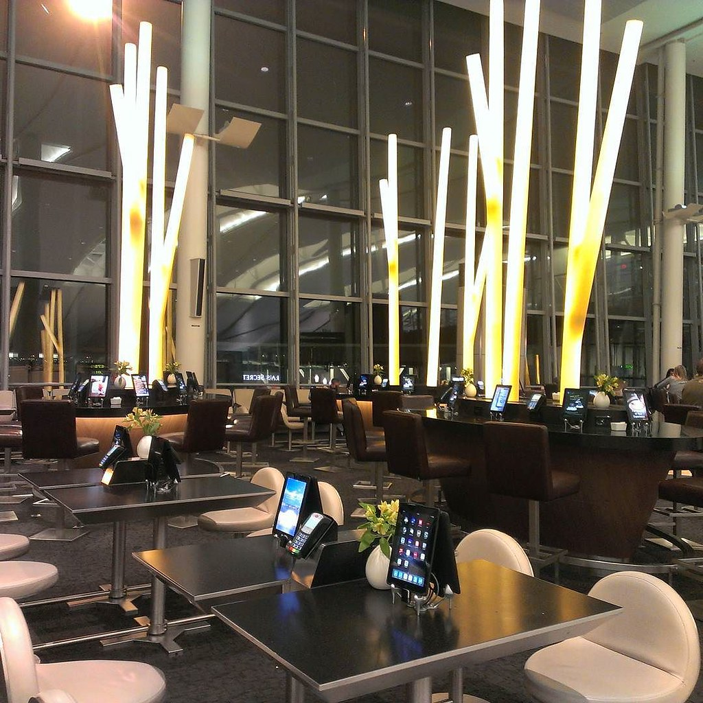 How amazing is this? New Toronto airport enhanced seating area with iPads where you can browse the internet, order food or drinks to be delivered ( no purchase necessary though!), keep track of your flight... Who needs an airport lounge when you have all