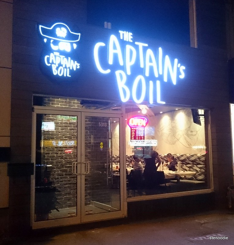 Captain's Boil storefront at night