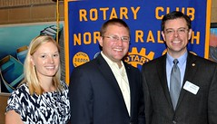 Meredith, and her newly inducted husband Brent Wright, share the photo with Club President Chris Morden.