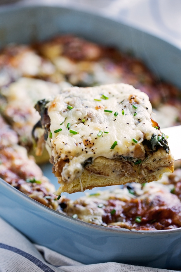 Caramelized Onion Spinach Feta Savory French Toast Casserole - The perfect casserole to make ahead and bake off in the morning. Hearty and delicious! #casserole #frenchtoastcasserole #breakfastcasserole #savoryfrenchtoast | Littlespicejar.com