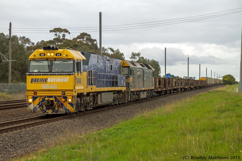 NR48-G538 with 2XM2 up steel goods from Port Augusta to Melbourne at Werribee (18/8/2015) by Bradley Matthews